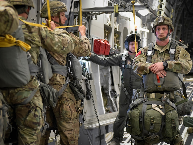 A line of 82nd Airborne Brigade paratroopers line up in front of their jumpmaster in preparation for a jump from a Charleston C-17 Globemaster III, May 25, at Fort Bragg, North Carolina. Aircrews from the 315th and 437th Airlift Wings  from Joint Base Charleston in 18 C-17 Globemaster IIIs provided the air transportation for the nearly 1,600 paratroopers. (U.S. Air Force Photo / Maj. Wayne Capps)