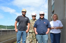 BG Mark Toy, Commanding General, Great Lakes and Ohio River Division presented Commander's Coins for Excellence to Kathy Eubanks, Chris Wilson and Travis Morgan during his recent visit to Meldahl Locks and Dam. General Toy was there to visit the Heavy Fleet while they were dewatering the main chamber in preparation of a miter gate replacement. Kathy Eubanks, Chris Wilson and Travis Morgan were recognized for their outstanding performance in the day-to-day operation of this critical piece of infrastructure.