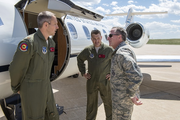 Gen. David Goldfein, Chief of Staff of the U.S. Air Force, speaks with Maj. Brian Jacobsen and Maj. Coy Egbert, pilots, 200th Airlift Squadron, during his visit to Buckley Air Force Base May 25. (U.S. Air National Guard Photo by Senior Master Sgt. John Rohrer)