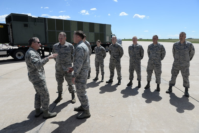 Gen. David Goldfein, Chief of Staff of the U.S. Air Force, speaks with Senior Master Sgt. Joe Wheeler and Lt. Col. Dono Kneuer, 140th Maintenance Group, during his visit to Buckley Air Force Base May 25. Standing behind are several outstanding Airmen from the 140 MXG. (U.S. Air National Guard Photo by Senior Master Sgt. John Rohrer)