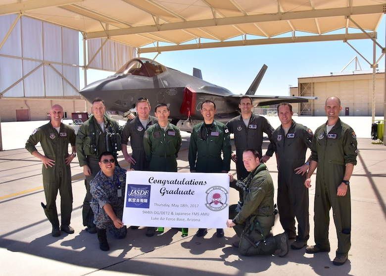 "Members from the 944th Operations Group Detachment 2 ""Ninjas"" and Japan Air Self-Defense Force, pose for a photo May 18 after the graduating JASDF F-35 pilot's final flight here at Luke Air Force Base, Ariz. (U.S. Air Force photo by Tech. Sgt. Louis Vega Jr.)"