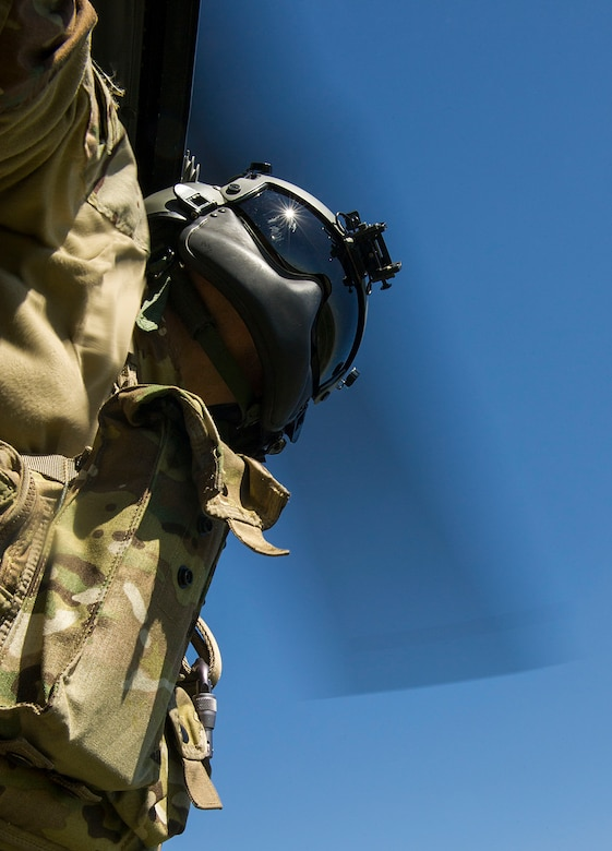 Tech. Sgt. Jamie Aulbach, 54th Helicopter Squadron flight engineer, prepares for landing during a training sortie in the missile complex, N.D., May 23, 2017. Airmen from the 54th HS teamed with 791st Missile Security Forces Squadron defenders to conduct security response training sorties. (U.S. Air Force photo/Senior Airman Apryl Hall)