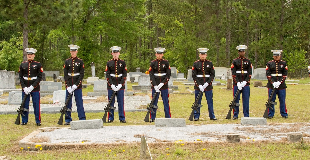 The honor guard team with Marine Corps Logistics Base Albany funeral detail prepares to fire three volleys from their rifles in honor of Marine Pfc. James O. Whitehurst at Cowarts Baptist Church Cemetery in Cowarts, Alabama, April 12, 2017.This tradition comes from tradition battle ceasefires where each side would clear the dead. The firing of three volleys indicated the dead were cleared and properly cared for. Whitehurst was killed in action at the battle of Tarawa during World War II, Nov. 23, 1943. (Marine Corps photo by Cpl. Krista James/Released)