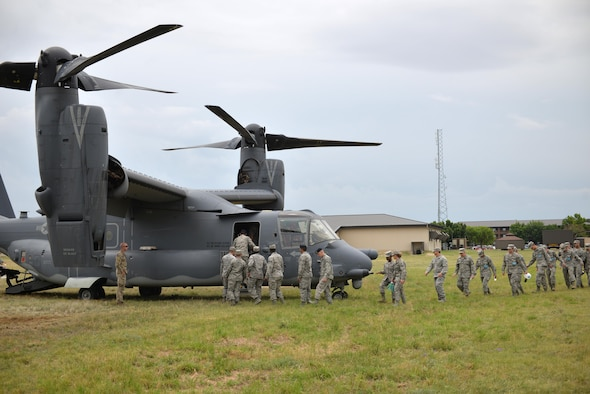 17th Training Wing students tour a CV-22 Osprey assigned to the 20th Special Operations Squadron, Goodfellow Air Force Base, Texas, May 30, 2017. The visit gave students a hands-on experience, allowing them to have a real-world picture of their job in the operational Air Force. (U.S. Air Force Photo by James R. Orlando/Released)