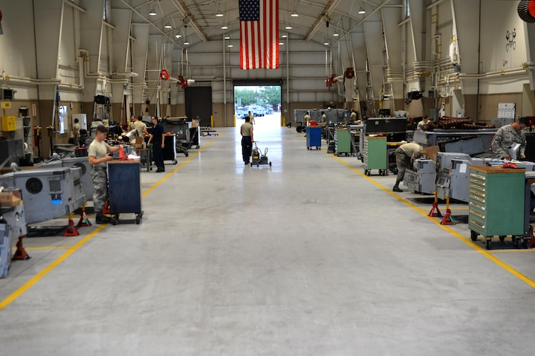 U.S. Airmen assigned to the 20th Equipment Maintenance Squadron aerospace ground equipment (AGE) flight perform their duties at Shaw Air Force Base, S.C., May 24, 2017. The AGE flight inspects and repairs all equipment entering the work center to include generators, bomb loaders and other pieces of equipment needed to complete flightline operations. (U.S. Air Force photo by Airman 1st Class Christopher Maldonado)
