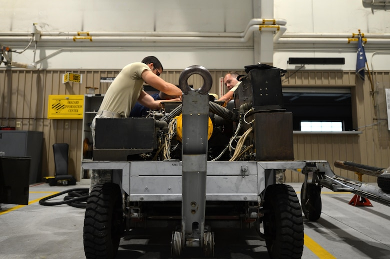 U.S. Air Force Staff Sgt. Michael Maldonado, left, and Senior Airman Stephen Kelly, 20th Equipment Maintenance Squadron aerospace ground equipment journeymen, perform maintenance on an A/M32A-60 generator at Shaw Air Force Base, S.C., May 24, 2017. An A/M32-60 is used by maintenance agencies to troubleshoot the output and input of the engine and electrical systems of the F-16CM Fighting Falcon. (U.S. Air Force photo by Airman 1st Class Christopher Maldonado)