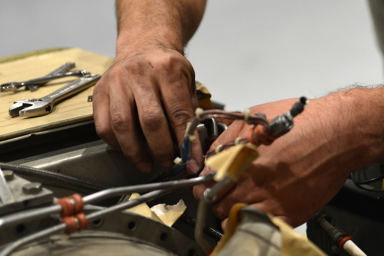 U.S. Air Force Senior Airman Stephen Kelly, 20th Equipment Maintenance Squadron aerospace ground equipment (AGE) journeyman, removes a bolt from an A/M32A-60 generator at Shaw Air Force Base, S.C., May 24, 2017. Airmen assigned to the AGE flight are trained to identify and correct mechanical errors in aircraft maintenance equipment such as generators and bomb loaders. (U.S. Air Force photo by Airman 1st Class Christopher Maldonado)