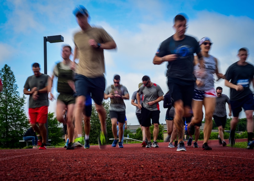 U.S. service members and their families begin a 1-mile run during a Memorial Day Murph and Pararescue Workout event at Joint Base Langley-Eustis, Va., May 29, 2017. The event included a variety of exercises and aimed to remember those who made the ultimate sacrifice for their country (U.S. Air Force photo/Staff Sgt. Areca T. Bell)