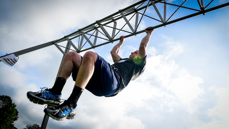 U.S. Air Force Senior Airman Derek Seifert, 633rd Air Base Wing photojournalist, performs a pull-up during a Memorial Day Murph and Pararescue Workout event at Joint Base Langley-Eustis, Va., May 29, 2017. Throughout the Murph Workout, participants ran a total of two miles, performed a total of 100 pullups, 200 pushups and 300 squats. (U.S. Air Force photo/Staff Sgt. Areca T. Bell)