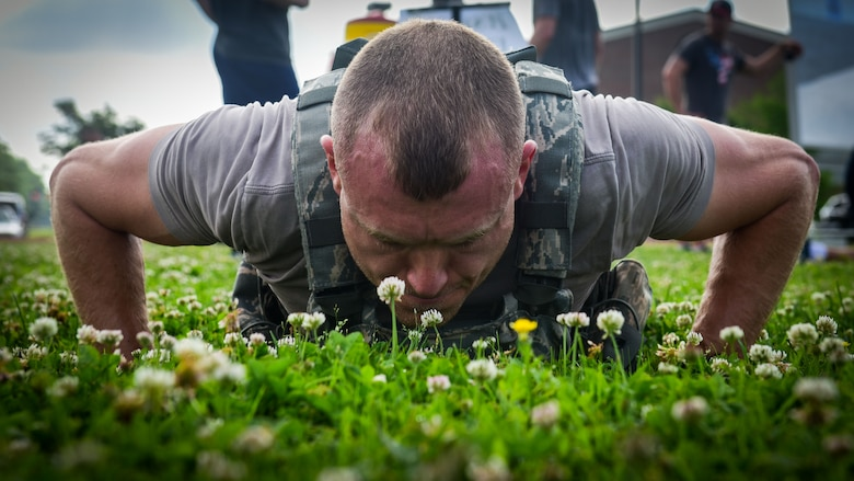 U.S. Air Force Tech. Sgt. Jared Martin, 633rd Security Forces Squadron police services NCO in charge, performs a push-up during a Memorial Day Murph and Pararescue Workout event at Joint Base Langley-Eustis, Va., May 29, 2017. During the event, participants performed a number of exercises in remembrance of those who made the ultimate sacrifice for their country. (U.S. Air Force photo/Staff Sgt. Areca T. Bell)