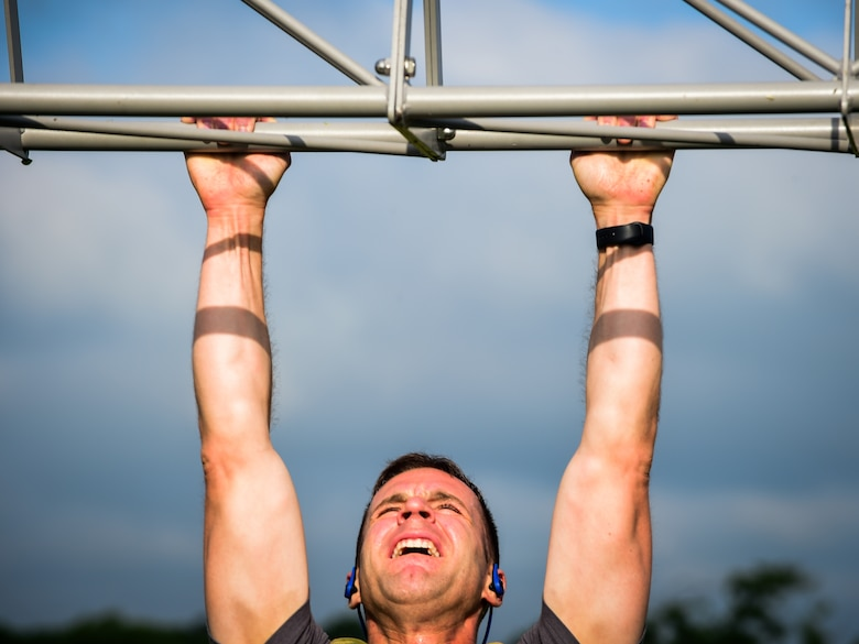 A participant does a pullup during a Memorial Day Murph and Pararescue Workout event at Joint Base Langley-Eustis, Va., May 29, 2017. Participants who opted to complete the Pararescue Workout ran a total of two miles, performed a total of 100 pullups, 400 burpees, 300 squats, 100 sit-ups and 400-meter tire flip. (U.S. Air Force photo/Staff Sgt. Areca T. Bell)