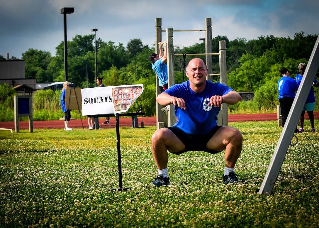 A participant does a squat during a Memorial Day Murph and Pararescue Workout event at Joint Base Langley-Eustis, Va., May 29, 2017. The event included a variety of exercises aimed to remember those who made the ultimate sacrifice. (U.S. Air Force photo/Staff Sgt. Areca T. Bell)
