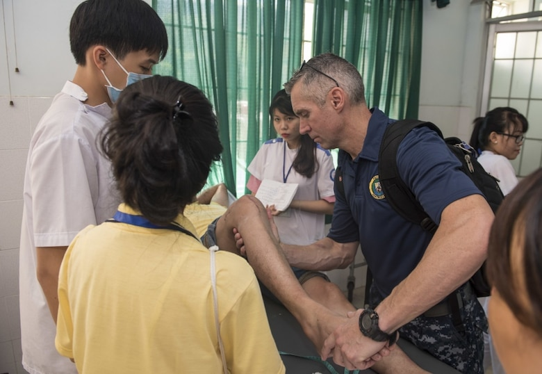 Cmdr. Robert Sheu from Naval Hospital Camp Pendleton assists local doctors and nurses in providing physical therapy to a patient at Nha Trang Traditional and Rehab Hospital during Pacific Partnership 2017 Khanh Hoa, May 24.  Pacific Partnership is the largest annual multilateral humanitarian assistance and disaster relief preparedness mission conducted in the Indo-Asia-Pacific and aims to enhance regional coordination in areas such as medical readiness and preparedness for manmade and natural disasters.
