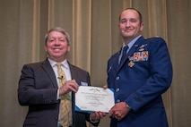 Retired Air Force Maj. Gen. Gregory A. Feest awards Air Command and Staff College student Maj. Ryan Mittelstet the Distinguished Flying Cross with Valor for his heroism in combat, May 30, 2017. Feest is one of the Eagles for the Gathering of the Eagles 2017. The GOE program brings together aviation heroes and pioneers to share their experiences and provide inspiration to future aviation leaders. Feest was a command pilot with more than 5,600 flying hours, including more than 800 combat hours earned during operations: Just Cause; Desert Storm; Iraqi Freedom; and Enduring Freedom. (U.S. Air Force Photo/ Donna L. Burnett/Released)