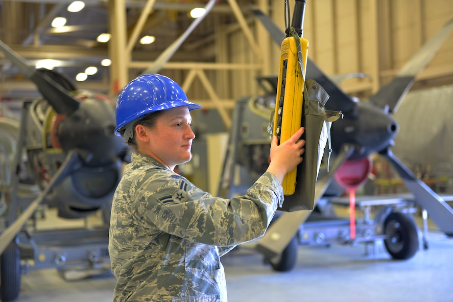 Airman Bridie Eckenrode, 361st Training Squadron student, installs a propeller retaining nut onto a T-56 Rolls Royce turboprop engine at Sheppard Air Force Base, Texas, May 24, 2017. This model propeller and engine combination are installed onto the C-130H aircraft. (U.S. Air Force photo by Liz H. Colunga/Released)