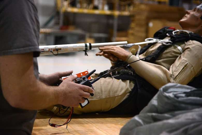 Trever Bush, 412th OSS Parachute Test Team, demonstrates the operation of the Remotely Piloted Parachute System he designed and built. The RPPS is designed to save time and money in recovery and dummy repair costs during parachute testing. (U.S. Air Force photo by Christopher Ball)