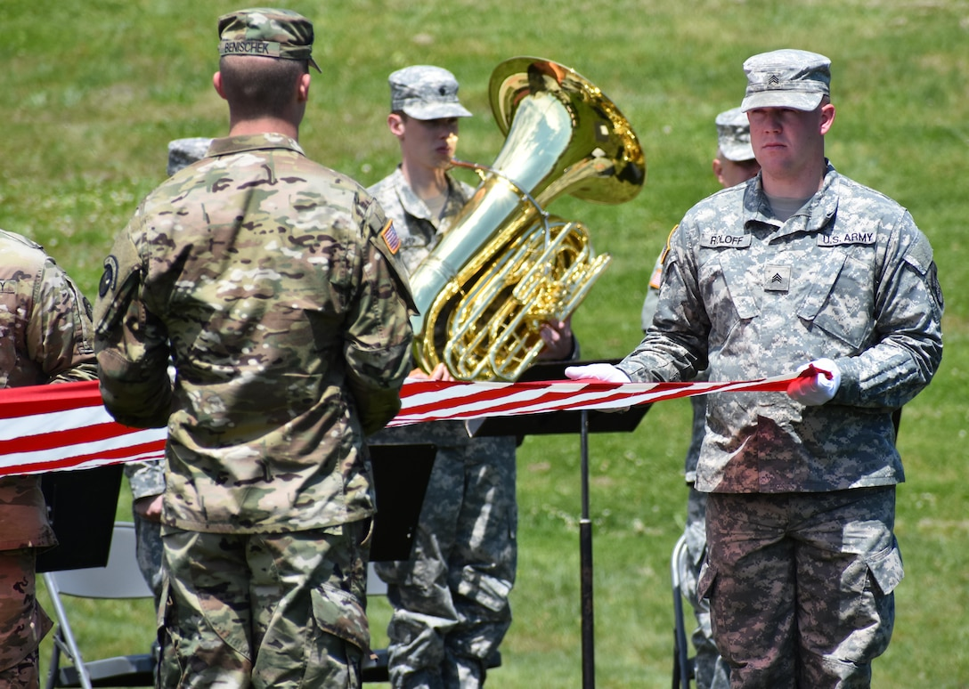 Members of the Iowa National Guard fold the flag as the band plays while conducting Retreat as the 88th Regional Support Command dedicates a plaque at Camp Dodge, Iowa on May 25, in honor of the 88th Infantry Division's beginning there in 1917. During the Command Retreat, Airmen, Soldiers, and Civilians are recognized by Maj. Gen. Timothy Orr, Adjutant General of the Iowa National Guard, for their contributions to the Guard and their communities, state and nation.