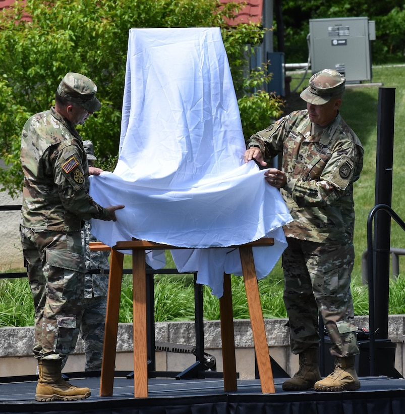 The 88th Regional Support Command unveils a plaque at Camp Dodge, Iowa on May 25, in honor of the 88th Infantry Division's beginning there in 1917. Maj. Gen. Patrick Reinert, 88th RSC commanding general (left), attended the Iowa National Guard Command Retreat hosted by Maj. Gen. Timothy Orr, Adjutant General of the Iowa National Guard (right), and dedicated the plaque in honor of the Blue Devil's 100 years of serving our Nation.