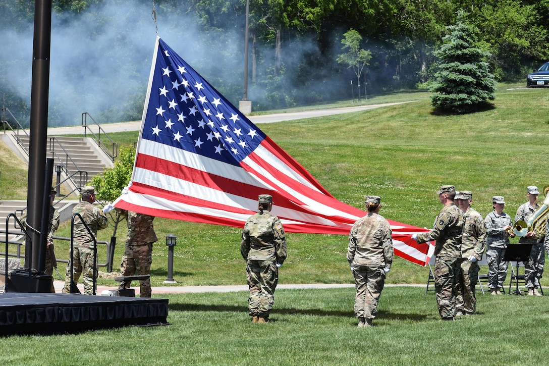 Members of the Iowa National Guard lower the flag while conducting Retreat as the 88th Regional Support Command dedicates a plaque at Camp Dodge, Iowa on May 25, in honor of the 88th Infantry Division's beginning there in 1917. During the Command Retreat, Airmen, Soldiers, and Civilians are recognized by Maj. Gen. Timothy Orr, Adjutant General of the Iowa National Guard, for their contributions to the Guard and their communities, state and nation.