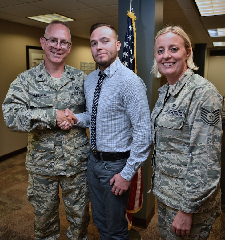 Nathaniel Syrcle, center,  stands with Lt. Col. Stan Paregien, left, and Tech. Sgt. Sara Seibel after having  recited the oath of enlistment, given by Paregien, May 31, 2017, Scott Air Force Base, Illinois. Syrcle will fulfill his dream to become a firefighter with the 932nd Civil Engineer Squadron.  For more information on how you can join the Air Force Reserve Command, contact Seibel, an Air Force Reserve recruiter with the 932nd Airlift Wing, at 618-781-1185.  (U.S. Air Force photo by Christopher Parr)