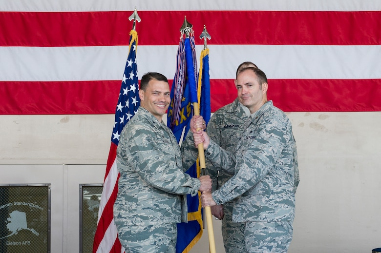 U.S. Air Force Col. Gregory Hutson, the 354th Maintenance Group commander, passes the 354th Maintenance Squadron, MXS guidon to Maj. Daniel Kline, the new 354th MXS commander, May 30, 2017, at Eielson Air Force Base, Alaska. Kline, took command from Maj. Timothy Stokes, who will serve as the 361st Training Squadron commander at Sheppard Air Force Base, Texas. (U.S. Air Force photo by Airman 1st Class Isaac Johnson)