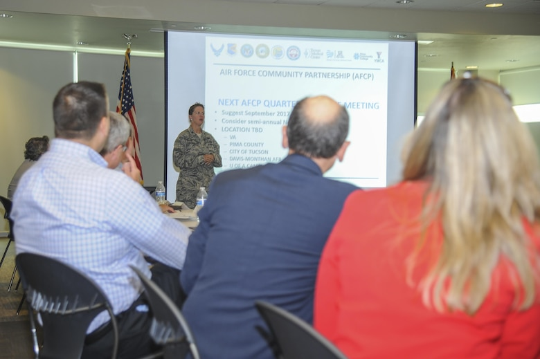 U.S. Air Force Col. Lauren Richter, 355th Mission Support Group commander, gives a briefing during an Air Force Community Partnership meeting at the Pima County Abrams Public Health Center in Tucson, Ariz., May 25, 2017. The meeting included budget briefings on current and future local projects as well as the history behind the coalition between Davis-Monthan Air Force Base, Ariz., and the Tucson population. (U.S. Air Force photo by Senior Airman Mya M. Crosby)