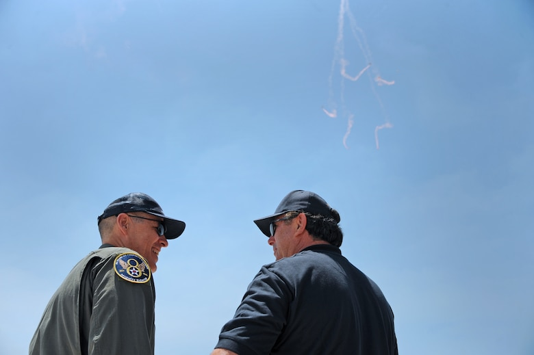 Maj. Gen. Thomas Bussiere, Eighth Air Force commander, left, attends the Salute to America's Heroes Air and Sea Show in Miami Beach, Fla., May 28, 2017. The weekend-long airshow allowed U.S. service member participants to demonstrate military technology and capabilities, while also educating the public about various aspects of the U.S. military. (U.S. Air Force photo by Senior Airman Erin Trower)