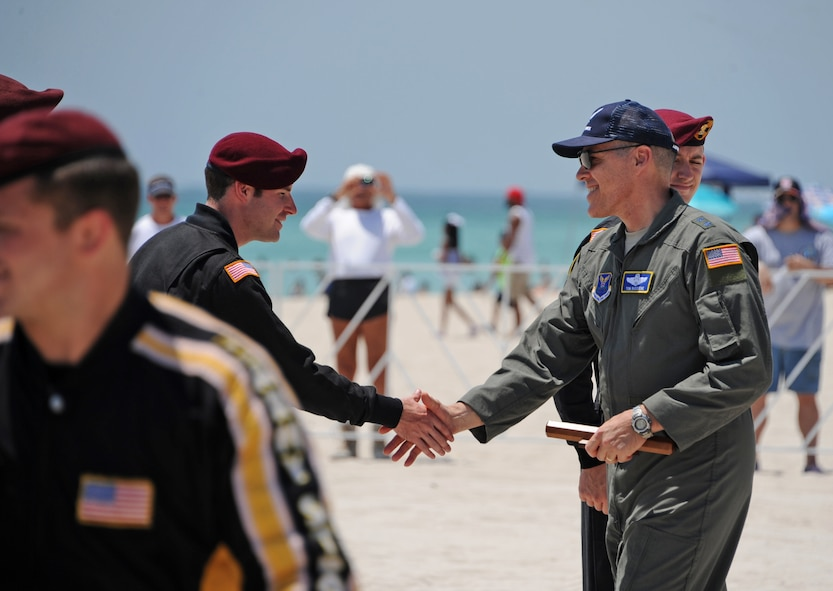 Maj. Gen. Thomas Bussiere, Eighth Air Force commander, receives a ceremonial baton from the U.S. Army Golden Knights Parachute Team during the Salute to America's Heroes Air and Sea Show in Miami Beach, Fla., May 28, 2017. Members representing all branches of the U.S. Armed Forces took part in the Memorial Day weekend airshow to increase public awareness and understanding of each branch's unique mission and capabilities. (U.S. Air Force photo by Senior Airman Erin Trower)
