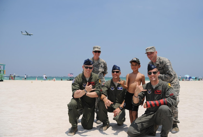 U.S. Air Force service members attend the Salute to America's Heroes Air and Sea Show in Miami Beach, Fla., May 28, 2017, to interact with the local public, educate and build community relations. Eighth Air Force bomber aircraft performed flyovers to provide the public with a capability display. (U.S. Air Force photo by Senior Airman Erin Trower)