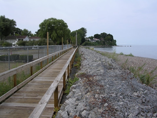 Facing west, the location is Lake Ontario shoreline, just west of the Olcott Harbor West Pier. Gabions were installed as part of Operation Foresight around 1973 or 1974. Photo was taken on Sept. 10, 2007.