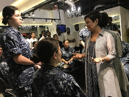 Ramani Fernando, right, owner of a hair salon in Colombo, talks to Sailors donating hair to make wigs for cancer patients in Sri Lanka. The Sailors are assigned to Ticonderoga-class guided-missile cruiser USS Princeton (CG 59), part of the Nimitz Carrier Strike Group (CSG). Nimitz CSG is on a regularly scheduled deployment in the 7th Fleet area of responsibility in support of maritime security operations and theater security cooperation efforts.