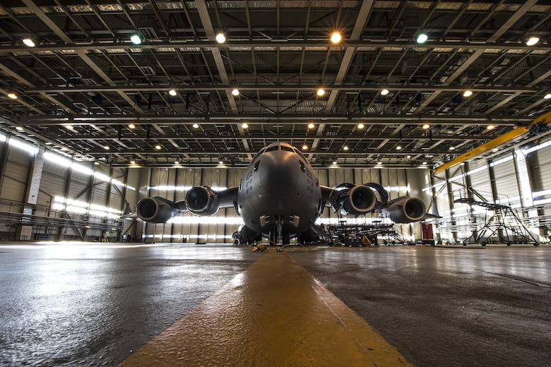 A U.S. Air Force C-17 Globemaster III assigned to the 437th Airlift Wing at Joint Base Charleston, South Carolina, sits in a hangar on Ramstein Air Base, Germany, Oct. 27, 2017. Airmen assigned to the 721st Aircraft Maintenance Squadron removed a damaged engine from the aircraft and replaced it with a new one. (U.S. Air Force photo by Senior Airman Devin Boyer)