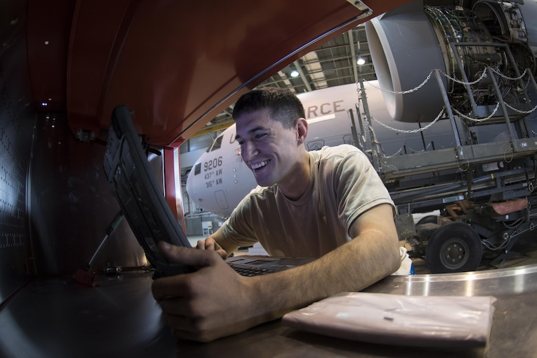 U.S. Air Force Senior Airman Taylor Corliss, 721st Aircraft Maintenance Squadron aerospace propulsion journeyman, reads schematics to a C-17 Globemaster III engine at a hangar on Ramstein Air Base, Germany, Oct. 27, 2017. The 721st AMXS works on aircraft from all over Air Mobility Command. (U.S. Air Force photo by Senior Airman Devin Boyer)