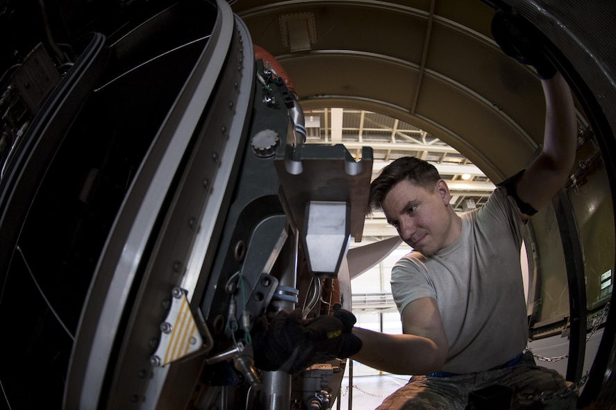 U.S. Air Force Staff Sgt. Amos Hard, 721st Aircraft Maintenance Squadron aerospace propulsion craftsman, matches a cradle mount to the engine of a C-17 Globemaster III at a hangar on Ramstein Air Base, Germany, Oct. 27, 2017. After mounting the engine to the cradle, Hard and his colleagues lowered the engine from the aircraft so they could put a new one in. (U.S. Air Force photo by Senior Airman Devin Boyer)