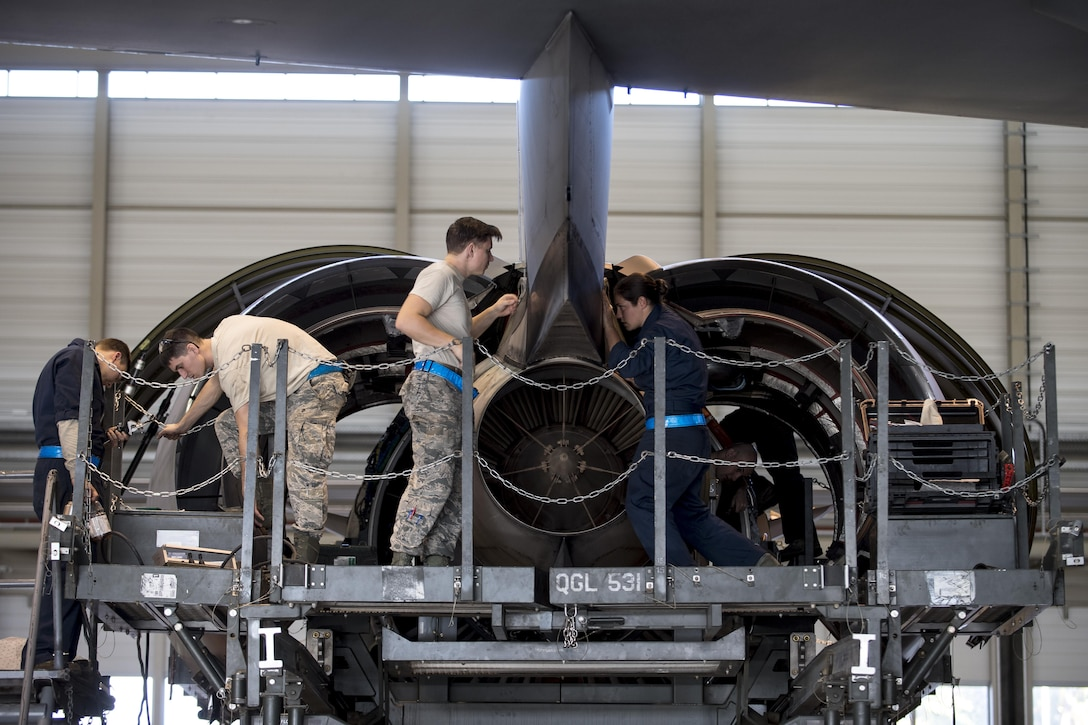 U.S. Air Force Airmen assigned to the 721st Aircraft Maintenance Squadron prepare a C-17 Globemaster III engine for removal at a hangar on Ramstein Air Base, Germany, Oct. 27, 2017. After removing the faulty engine, the maintainers lift the new engine in its place and bolt it to the aircraft. The faulty engine then gets sent to a facility where technicians diagnose the issues it has and refurbish it so it is operable again. (U.S. Air Force photo by Senior Airman Devin Boyer)