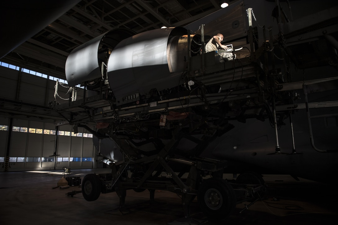 U.S. Air Force Senior Airman Cody Logan, 721st Aircraft Maintenance Squadron aerospace propulsion journeyman, begins to lower a damaged C-17 Globemaster III engine at a hangar on Ramstein Air Base, Germany, Oct. 27, 2017. The maintainers then wheeled the damaged engine away to place the new engine in its place. The engine swap took about 72 hours to complete. (U.S. Air Force photo by Senior Airman Devin Boyer)