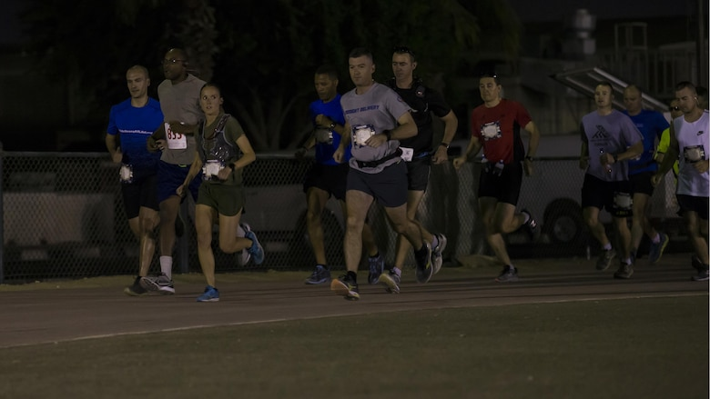U.S. Marine Capt. Danielle Pozun, Special Purpose Marine Air-Ground Task Force – Crisis Response – Central Command leads the pack at the beginning of the 42nd Marine Corps Marathon while deployed in the Middle East Oct. 22, 2017. The Marine Corps Marathon is one of the largest marathons in the world and hosts the event in forward locations to allow service members outside the United States an opportunity to compete.