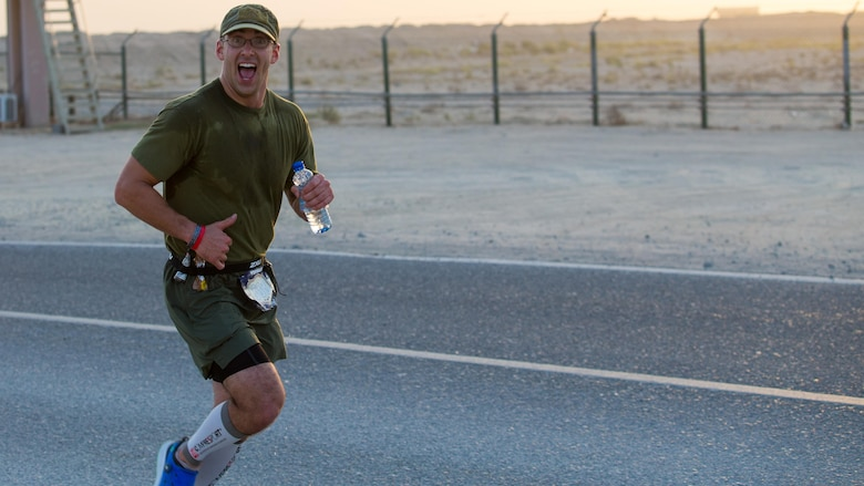 Chief Warrant Officer 2 Jonathan Eaton, mobility officer for Special Purpose Marine Air-Ground Task Force – Crisis Response – Central Command reaches the 10-mile marker of the 42nd Marine Corps Marathon while deployed in the Middle East Oct. 22, 2017. The Marine Corps Marathon is one of the largest marathons in the world and hosts the event in forward locations to allow service members outside the United States an opportunity to compete.