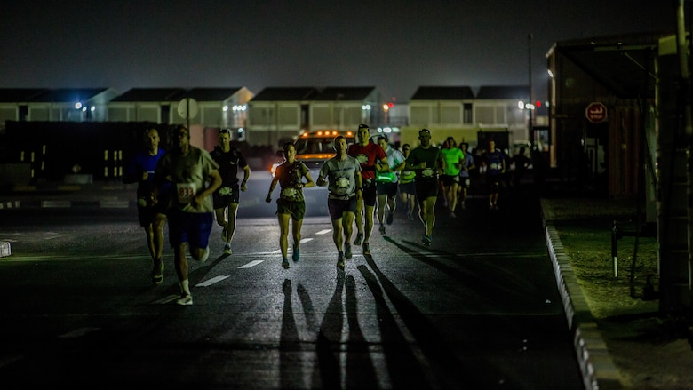 Captain Danielle Pozun (center left) a Marine deployed with Special Purpose Marine Air-Ground Task Force – Crisis Response – Central Command and a member of the Marine Corps Running Team, runs the 42nd Marine Corps Marathon Forward while in the Middle East Oct. 22, 2017. The Marine Corps Marathon is one of the largest marathons in the world and hosts the event in forward locations to allow service members outside the United States an opportunity to compete.