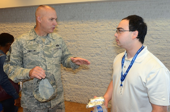 Chief Master Sgt. Thomas Zwelling, Air Force Reserve Command Recruiting Service manager, speaks with an individual ready reserve participant. (U.S. Air Force photo by Master Sgt. Chance Babin)