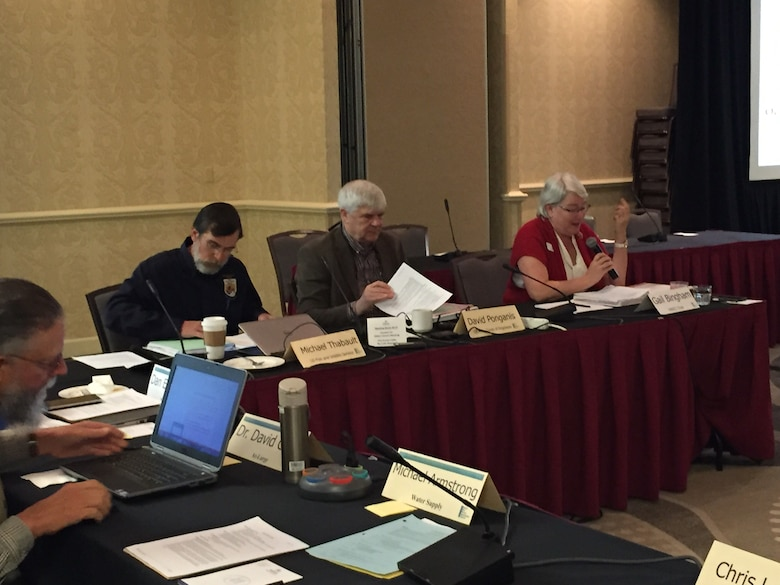 U.S. Fish and Wildlife Service representative, U.S. Army Corps of Engineers representative, and MRRIC chair seated at a table.