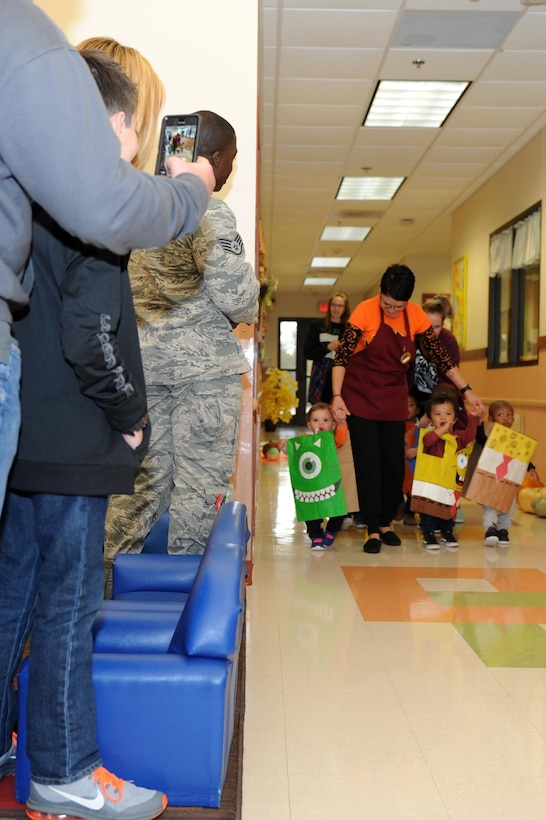 A photo depicting the Paper Bag Day Costume Parade.