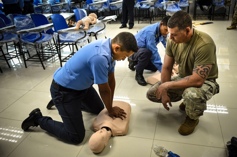 Joint Security Forces and local police forces participate in Subject Matter Expert Exchange to practice life saving techniques for emergency situations.