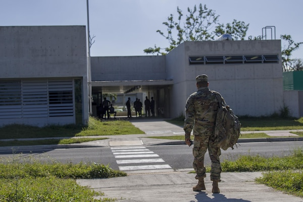 An Army ROTC instructor arrives on the University of Puerto Rico campus in San Juan, Puerto Rico, as cadets return to class for the first time since Hurricanes Irma and Maria, Oct. 31, 2017. Army photo by Sgt. Avery Cunningham