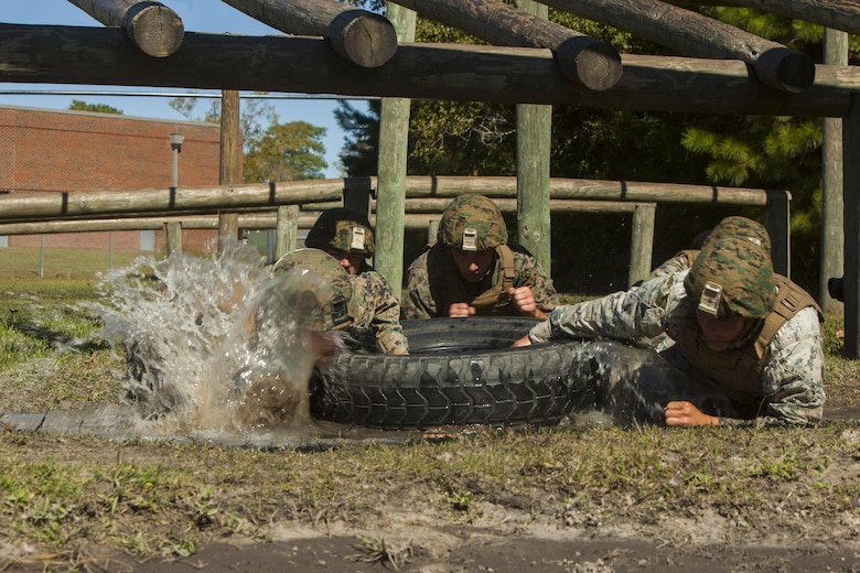 U.S. Marines with Battalion Landing Team 2nd Battalion, 6th Marine Regiment, 26th Marine Expeditionary Unit (MEU), drag a tire across a muddy field during a Martial Arts Instructor Course (MAIC) at Marine Corps Base Camp Lejeune, N.C., Oct. 26, 2017.