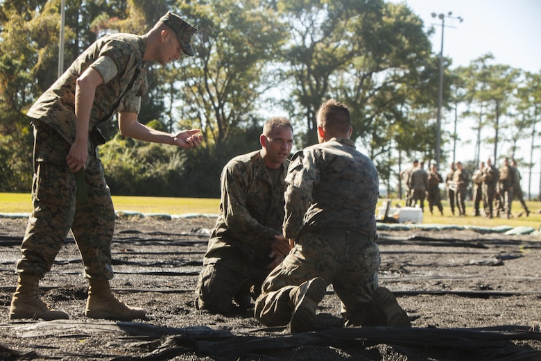 U.S. Marine Corps Lt. Col. Marcus Mainz, the battalion commander of Battalion Landing Team 2nd Battalion, 6th Marine Regiment, 26th Marine Expeditionary Unit (MEU), prepares to ground fight against Cpl. Devon Marden, an infantry Marine also with BLT 2/6, during a Martial Arts Instructor Course (MAIC) at Marine Corps Base Camp Lejeune, N.C., Oct. 26, 2017.