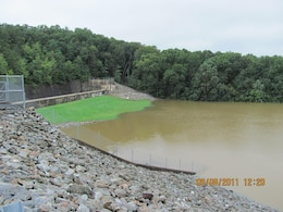 Waters from Tropical Storm Lee are seen here in the normally dry reservoir behind Indian Rock Dam September 8, 2011. To the left is the dam's concrete overflow spillway. The water in the reservoir peaked at 44.1 percent capacity during Tropical Storm Lee. Had the reservoir's capacity been exceeded, water would have flowed into the concrete spillway and made its way downstream so as to not risk putting too much pressure on the dam. Tropical Storm Lee caused devastating flooding in parts of Pennsylvania and other states, but in York its impacts were greatly reduced by Indian Rock Dam.