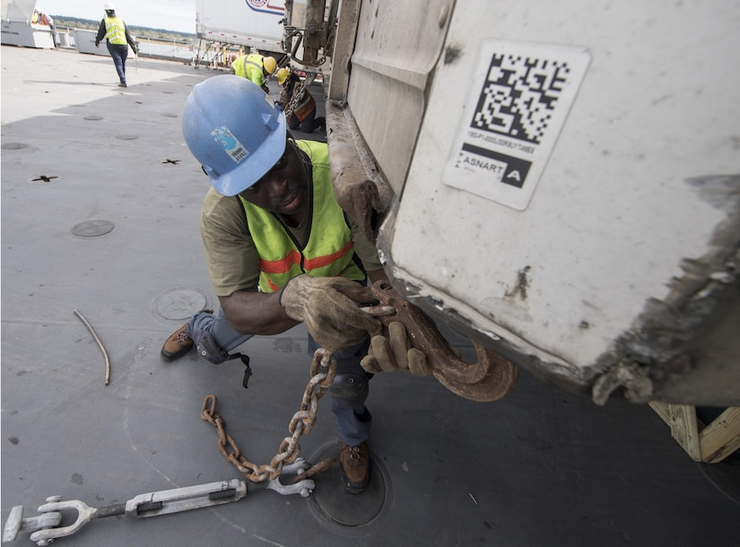 A longshoreman secures a 54-foot trailer to the USNS Brittin (T-AKR-305)  Oct. 28, 2017, at Joint Base Charleston-Weapons Station, S.C.
