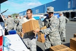 Airmen with the 156th Airlift Wing deliver water and meals to La Resurrecion del Señor church in the municipality of Canovanas, Puerto Rico, Oct. 31, 2017. The Puerto Rico Air National Guard has teamed up with the Foundation for Puerto Rico to deliver supplies to at-risk populations throughout the island. Air National Guard photo by Staff Sgt. Daniel J. Martinez
