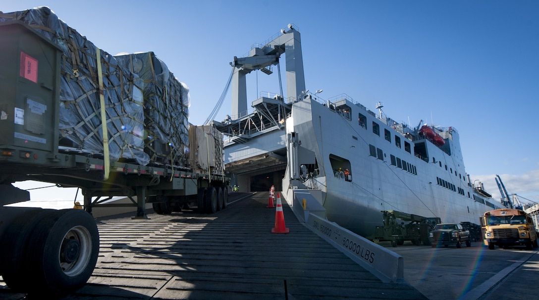 Cargo is driven onto the USNS Brittin (T-AKR-305) by a flatbed truck on the Joint Base Charleston Naval Weapons Station Oct. 28, 2017.